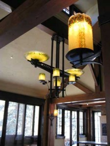 Custom glass pendant and sconces lit with LEDs